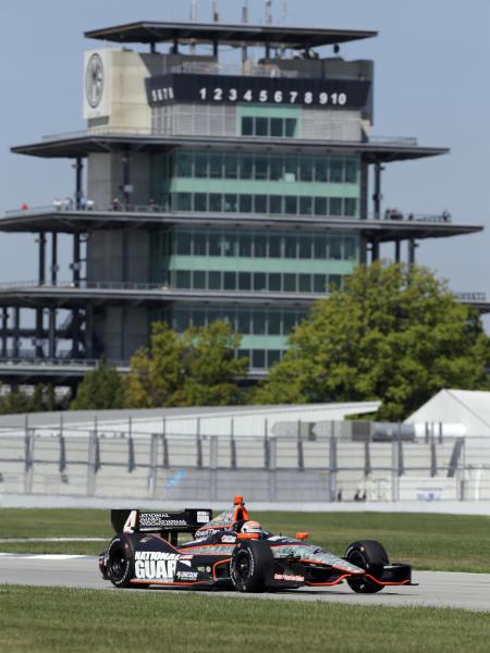 IndyCar driver Ryan Briscoe, of Australia, drives through a turn during a road course test at the Indianapolis Motor Speedway in Indianapolis, Wednesday, Sept. 4, 2013. (AP Photo/Michael Conroy)
