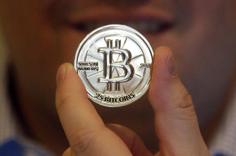 Bitcoin bursts: Hacker currency gets wild ride