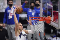 Dallas Mavericks center Kristaps Porzingis dunks during the first half in Game 5 of an NBA basketball first-round playoff series against the Los Angeles Clippers Wednesday, June 2, 2021, in Los Angeles. (AP Photo/Mark J. Terrill)
