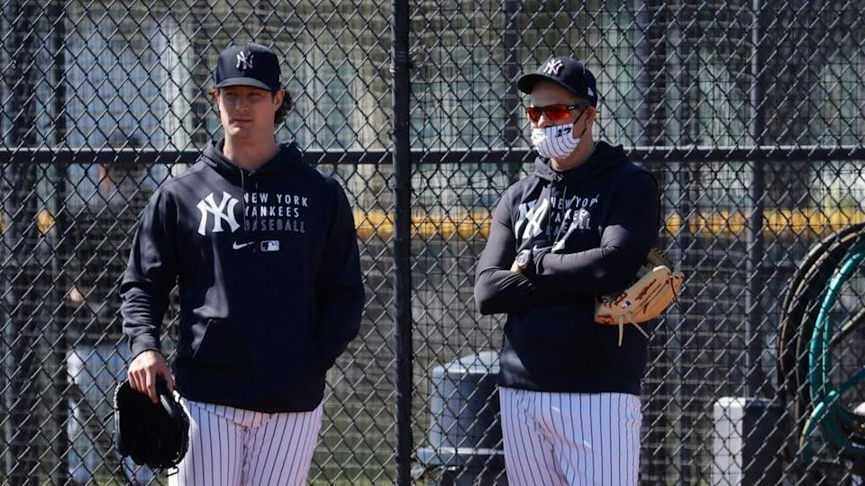 Gerrit Cole and Aaron Boone look on during spring training