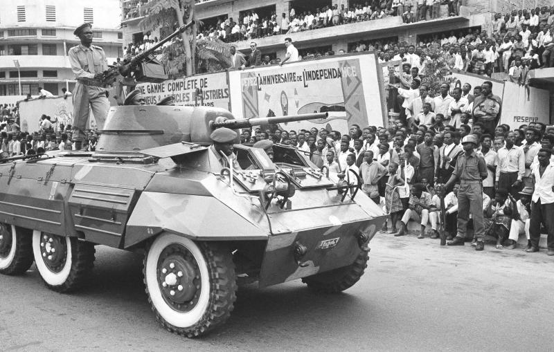 FILE - In this June 30, 1961 file photo, Congo celebrates the first anniversary of independence from Belgium with a large military parade in Leopoldville, the capital before it was later renamed in 1966 to Kinshasa, in Congo. On Tuesday, June 30, 2020 Congo is marking the 60th anniversary of achieving independence from the colonial rule of Belgium. (AP Photo/Horst Faas, File)