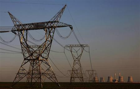 Electricity pylons are seen in front of the Kendal Power Station, a coal-fired power station in Witbank