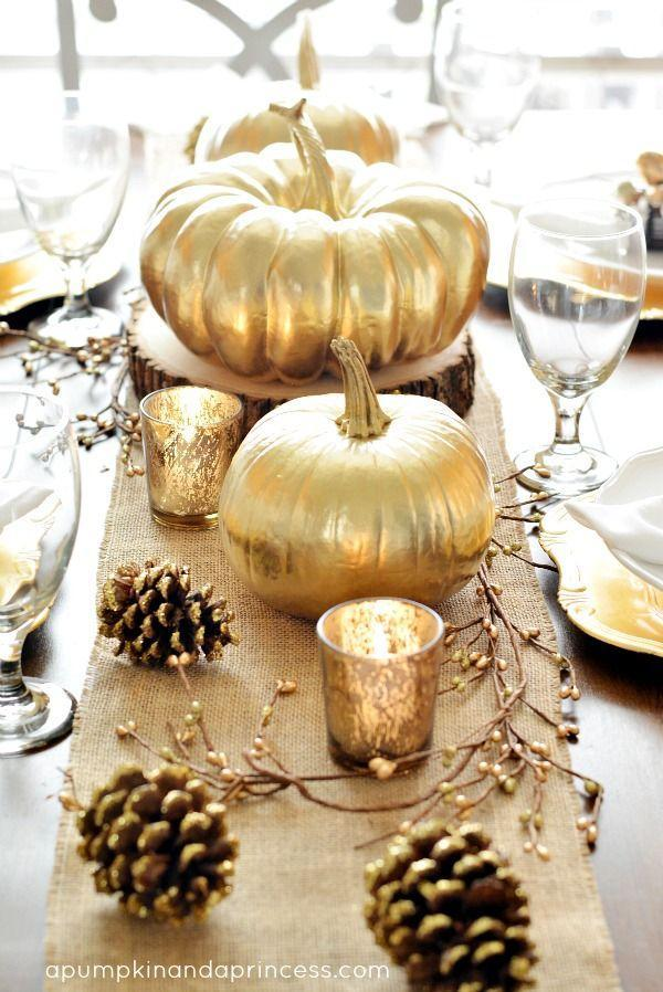 "<p>Oh, you fancy, huh? A gold runner, gold pinecones, gold votives, and gold pumpkins — basically, go gold or go home.</p><p>See more at <a href=""https://apumpkinandaprincess.com/thanksgiving-inspired-gold-table-decor-dinner-party/"" rel=""nofollow noopener"" target=""_blank"" data-ylk=""slk:A Pumpkin and A Princess"" class=""link rapid-noclick-resp"">A Pumpkin and A Princess</a>.</p>"