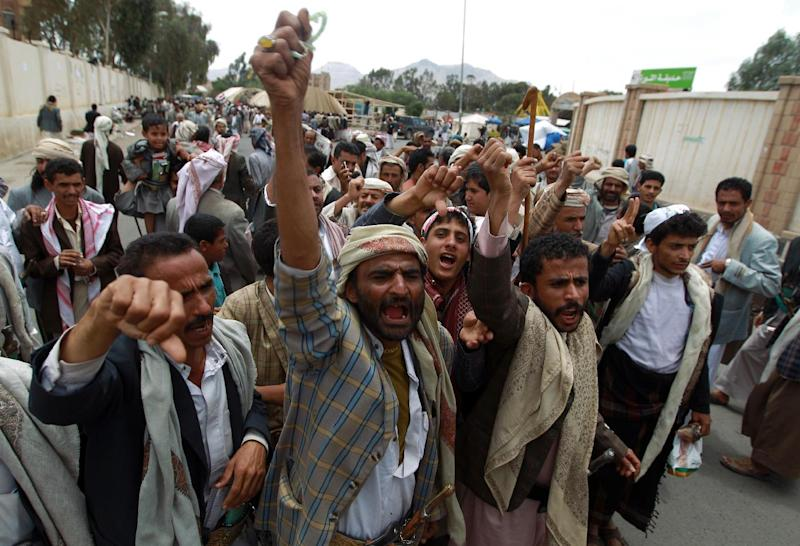 Members of the Shiite Huthi movement shout slogans during a demonstration pressing the Yemeni government to quit at an encampment in northern Sanaa on August 23, 2014