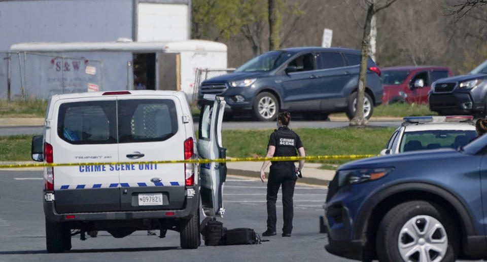 Police officer shown standing next to a police car at the scene of the rampage. Source: AP
