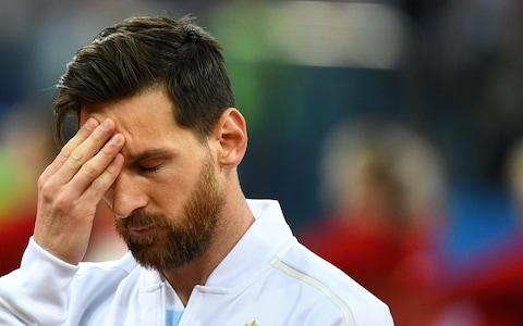 Lionel Messi touches his forehead before the Russia 2018 World Cup Group D football match between Argentina and Croatia - Credit: JOHANNES EISELE/AFP