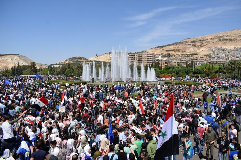 Syrians rally in Damascus' Omayyad square on April 16, 2018 in support of President Bashar al-Assad following Western air strikes against the regime over an alleged chemical attack