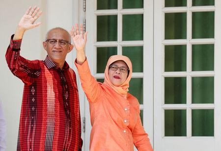 Former speaker of Singapore's parliament, Halimah Yacob, arrives with her husband Mohammed Abdullah Alhabshee to submit her presidential nomination papers at the nomination centre in Singapore September 13, 2017. REUTERS/Edgar Su