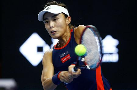 Wang on brink of year's biggest win as rain stops play