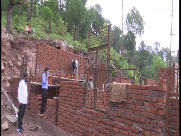 Construction work resumed after the PMAY beneficiaries received their first installment in Rajouri district of Jammu and Kashmir. (Photo/ANI)