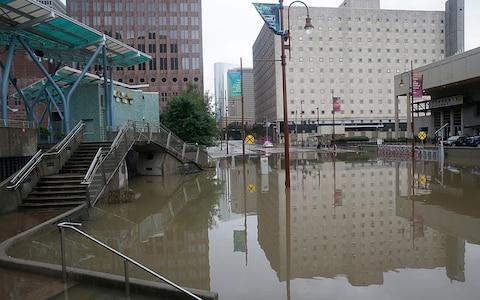 The theatre district of Houston is flooded - Credit: AFP