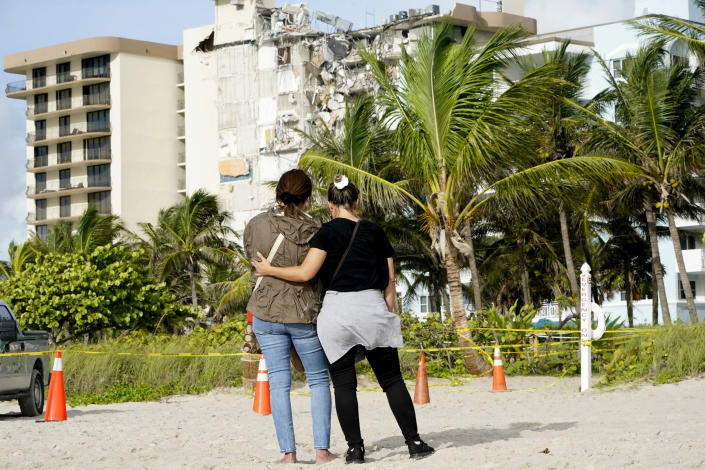Image: Maria Fernanda Martinez and Mariana Corderiro of Boca Raton, Fla., on Friday stand outside of a 12-story beachfront condo building that partially collapsed. (Lynne Sladky / AP)