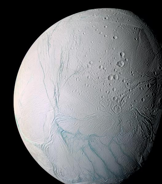 "This undated photo provided by NASA on April 2, 2014 shows Saturn's moon Enceladus. The ""tiger stripes"" are long fractures from which water vapor jets are emitted. Scientists have uncovered a vast ocean beneath the icy surface of the moon, they announced Thursday, April 3, 2014. Italian and American researchers made the discovery using Cassini, a NASA-European spacecraft still exploring Saturn and its rings 17 years after its launch from Cape Canaveral. (AP Photo/NASA, JPL, Space Science Institute)"