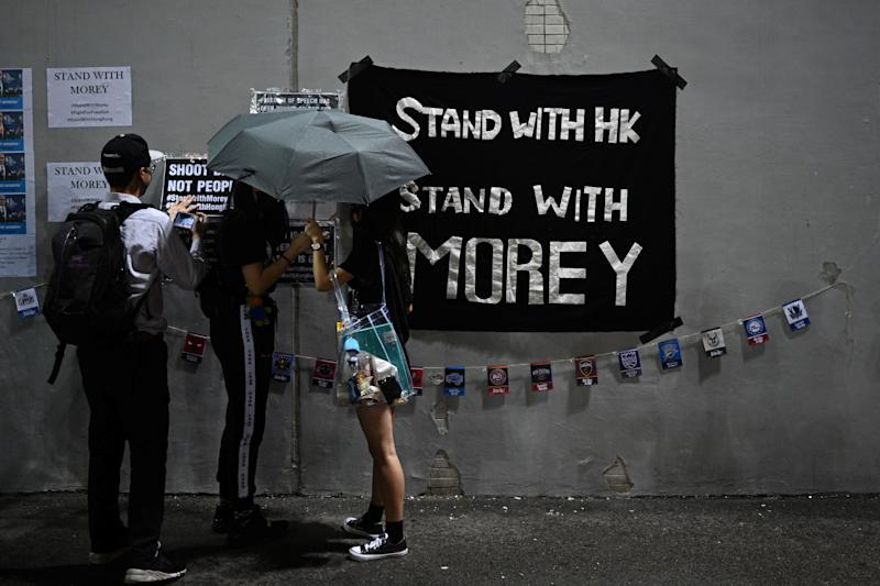 "Protesters display posters at the Southorn Playground in Hong Kong on October 15, 2019, during a rally in support of NBA basketball Rockets general manager Daryl Morey and against comments made by Lakers superstar LeBron James. - US basketball superstar LeBron James on October 14, 2019, has sharply criticised a Houston Rockets executive for angering China with a tweet supporting protesters in Hong Kong, saying the executive was ""misinformed"" and should have kept his mouth shut. (Photo by Anthony WALLACE / AFP) (Photo by ANTHONY WALLACE/AFP via Getty Images)"