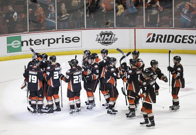 Anaheim Ducks players celebrate their team's 4-3 win against the Dallas Stars in Game 1 of the first-round NHL hockey Stanley Cup playoff series on Wednesday, April 16, 2014, in Anaheim, Calif. (AP Photo/Jae C. Hong)