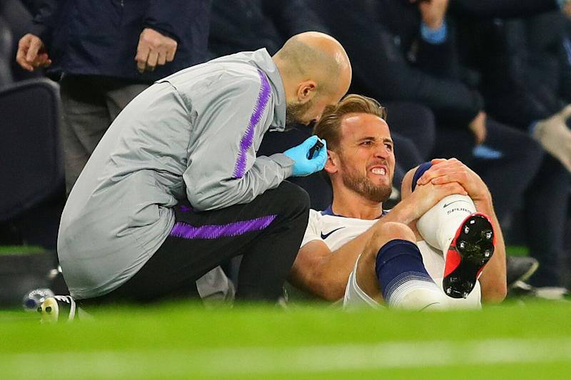 Harry Kane clutches his left leg after suffering an ankle injury against Manchester City (Photo by Chris Brunskill/Fantasista/Getty Images)