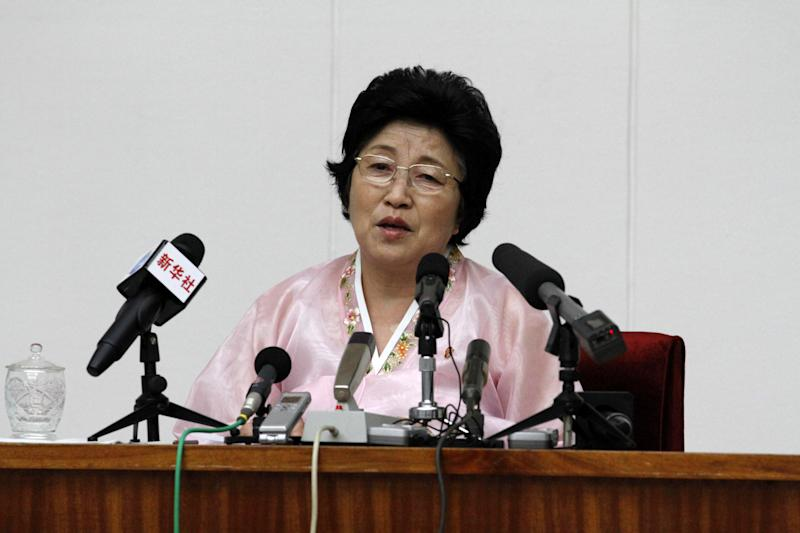 North Korean Pak Jong Suk speaks to reporters at the People's Palace of Culture in Pyongyang, North Korea, on Thursday, June 28, 2012. Pak told local and foreign reporters she was tricked into defecting to South Korea by agents who offered to arrange a reunion with her long-lost father, but returned home after being disillusioned with life in the South. Her account could not be verified by South Korean officials. (AP Photo/Kim Kwang Hyon)