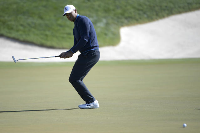 Tiger Woods reacts after missing a putt for birdie on the 18th green during the first round of the Arnold Palmer Invitational golf tournament Thursday, March 15, 2018, in Orlando, Fla. (AP Photo/Phelan M. Ebenhack)