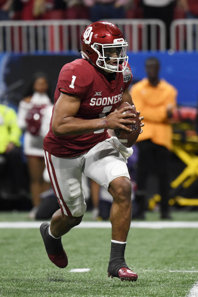 Oklahoma quarterback Jalen Hurts (1) runs against LSU during the first half of the Peach Bowl NCAA semifinal college football playoff game, Saturday, Dec. 28, 2019, in Atlanta. (AP Photo/Danny Karnik)