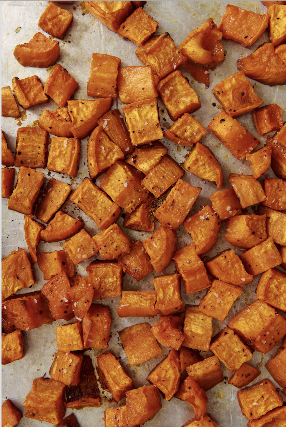"""<p><a href=""""https://www.delish.com/uk/cooking/recipes/g33977250/sweet-potato-recipes/"""" rel=""""nofollow noopener"""" target=""""_blank"""" data-ylk=""""slk:Sweet potatoes"""" class=""""link rapid-noclick-resp"""">Sweet potatoes</a> are one of the most versatile ingredients in the kitchen. They're amazing boiled, baked, sautéed, and fried. (ILY, <a href=""""https://www.delish.com/uk/cooking/recipes/a31012172/air-fryer-sweet-potato-recipe/"""" rel=""""nofollow noopener"""" target=""""_blank"""" data-ylk=""""slk:sweet potato fries"""" class=""""link rapid-noclick-resp"""">sweet potato fries</a>.) But one of the easiest and most useful ways to cook sweet potatoes is to roast them. </p><p>Get the <a href=""""https://www.delish.com/uk/cooking/recipes/a30311290/how-to-roast-sweet-potatoes/"""" rel=""""nofollow noopener"""" target=""""_blank"""" data-ylk=""""slk:Roasted Sweet Potatoes"""" class=""""link rapid-noclick-resp"""">Roasted Sweet Potatoes</a> recipe.</p>"""