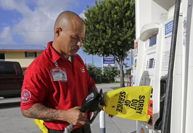 <p>Gas station employee Albert Fernandez covers a pump after running out of gas as the demand for gas has increased due to Hurricane Irma, Wednesday, Sept. 6, 2017, in Key Largo, Fla. (Photo: Alan Diaz/AP) </p>