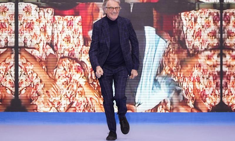 Paul Smith walks the runway during his show
