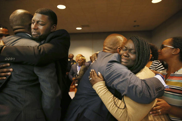 Odell Edwards and Charmaine Edwards, parents of Jordan Edwards, react to a guilty of murder verdict during a trial of fired Balch Springs police officer Roy Oliver, who was charged with the murder of 15-year-old Jordan Edwards, at the Frank Crowley Courts Building in Dallas on Tuesday, Aug. 28, 2018. (Rose Baca/The Dallas Morning News via AP, Pool)