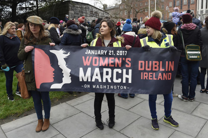 <p>Protesters pose for a photograph with a banner before they take part in the Women's March on Dublin Jan. 21. (Reuters/Clodagh Kilcoyne) </p>