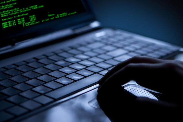 illicit virtual currency funding cybercriminal organizations spooky hacker hands
