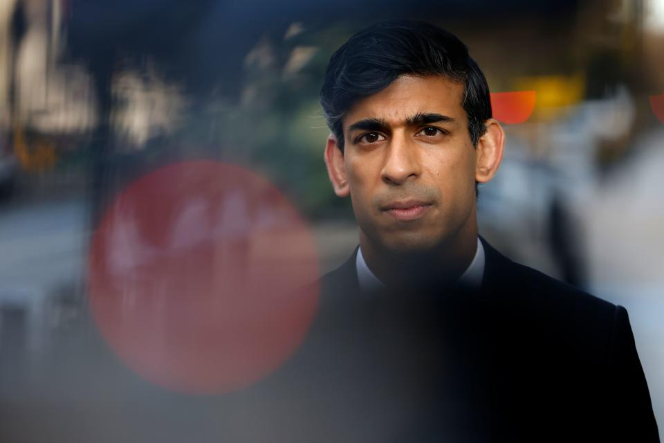 Britain's Chancellor of the Exchequer Rishi Sunak reacts during a media interview after arriving at the BBC in central London on November 22, 2020, to take appear on the BBC political programme The Andrew Marr Show. - Britain's debt is now at its highest level since 1961 as a share of GDP, after the government embarked on a massive spending spree to mitigate the economic effects of the COVID-19 coronavirus pandemic and resulting lockdowns. (Photo by Tolga Akmen / AFP) (Photo by TOLGA AKMEN/AFP via Getty Images)