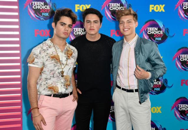 <p>Emery Kelly, Liam Attridge and Ricky Garcia of <i>Forever in Your Mind</i>'s looks pull from the 80s and 90s for inspiration. (Photo: Getty Images) </p>