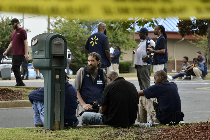 Employees gather in a nearby parking lot after a shooting at a Walmart store Tuesday, July 30, 2019 in Southaven, Miss. (Photo: Brandon Dill/AP)