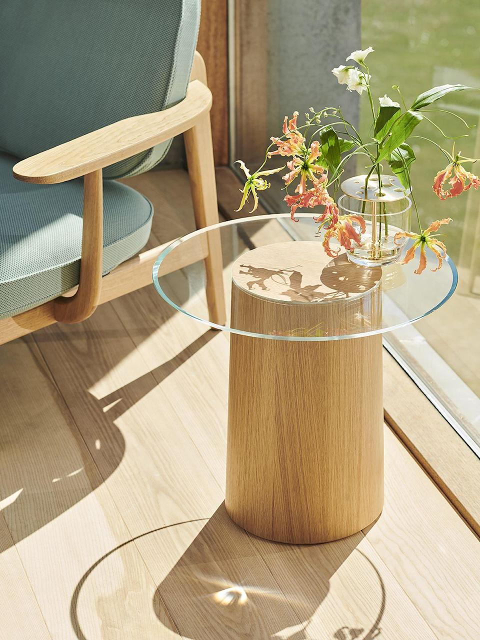 """<p>Inspired by a wooden 'stump' – 'stub' is Danish for stump – this simple side table required a series of experiments to master the joining of materials without any glue or visible fixings. The glass and base are cut at a 45-degree angle so they lock into position smoothly. £507, <a href=""""https://www.fritzhansen.com"""" rel=""""nofollow noopener"""" target=""""_blank"""" data-ylk=""""slk:fritzhansen.com"""" class=""""link rapid-noclick-resp"""">fritzhansen.com</a></p>"""