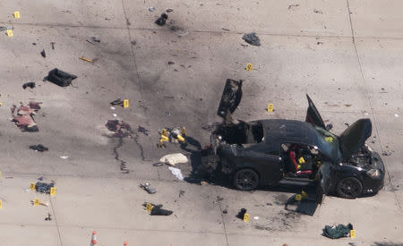 The car that was used the previous night by two gunmen is investigated by local police and the FBI in Garland