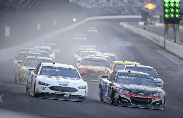 "<a class=""link rapid-noclick-resp"" href=""/nascar/sprint/drivers/396/"" data-ylk=""slk:Kasey Kahne"">Kasey Kahne</a> (5), right, takes the lead on the final restart as he heads into the first turn with <a class=""link rapid-noclick-resp"" href=""/nascar/sprint/drivers/1124/"" data-ylk=""slk:Brad Keselowski"">Brad Keselowski</a> (2) on his way to winning the NASCAR Brickyard 400 auto race at Indianapolis Motor Speedway, in Indianapolis Sunday, July 23, 2017. (AP Photo/AJ Mast)"