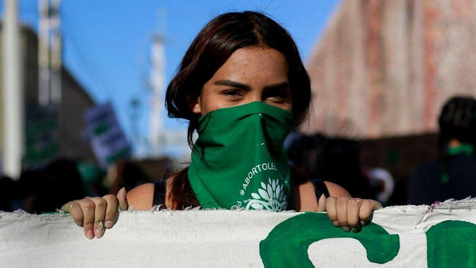 A demonstrator wears a green handkerchief at a demonstration in favour of decriminalising abortion on the International Safe Abortion Day, 28 September 2020 in Queretaro, Mexico