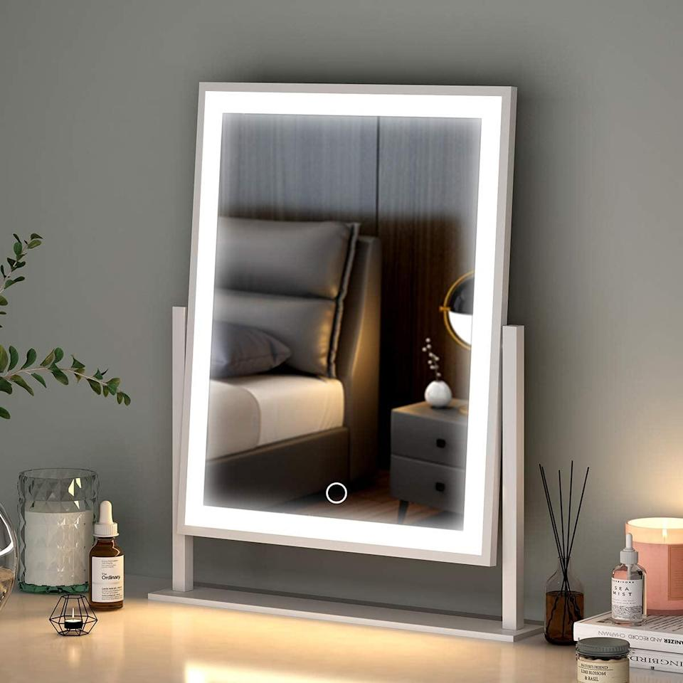 <p>The sleek <span>Lighted Makeup Mirror with Smart Touch Control</span> ($60) has a tri-color dimmable light and the mirror has a 360 degree rotation. It's a great option for those who don't want something too big and clunky. </p>