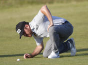 South Africa's Louis Oosthuizen looks at his ball as it lies in a divot mark on the 17th fairway during the third round of the British Open Golf Championship at Royal St George's golf course Sandwich, England, Saturday, July 17, 2021. (AP Photo/Peter Morrison)