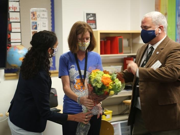 Indian Trail Elementary School Principal Maria Grable, at center, is presented with flowers by North Shore School District 112 administrators at a Sept. 24 ceremony honoring the school's designation as a National Blue Ribbon School. (North Shore School District 112)