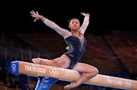"""<p>At the start of the Tokyo Olympic Games, Lee became the <a href=""""https://people.com/sports/tokyo-olympics-sunisa-lee-first-hmong-american-olympic-gymnast-achieving-her-dream/"""" rel=""""nofollow noopener"""" target=""""_blank"""" data-ylk=""""slk:first Hmong American Olympic gymnast"""" class=""""link rapid-noclick-resp"""">first Hmong American Olympic gymnast</a> and now, she's the <a href=""""https://people.com/sports/tokyo-olympics-womens-gymnastics-individual-all-around-winners/"""" rel=""""nofollow noopener"""" target=""""_blank"""" data-ylk=""""slk:first Hmong American Olympic gold medalist"""" class=""""link rapid-noclick-resp"""">first Hmong American Olympic gold medalist</a>.</p> <p>The 18-year-old placed first at the women's gymnastics individual all-around event on Thursday, making Team USA the proud winner of five straight women's all-around golds, starting with Carly Patterson in 2004.</p>"""