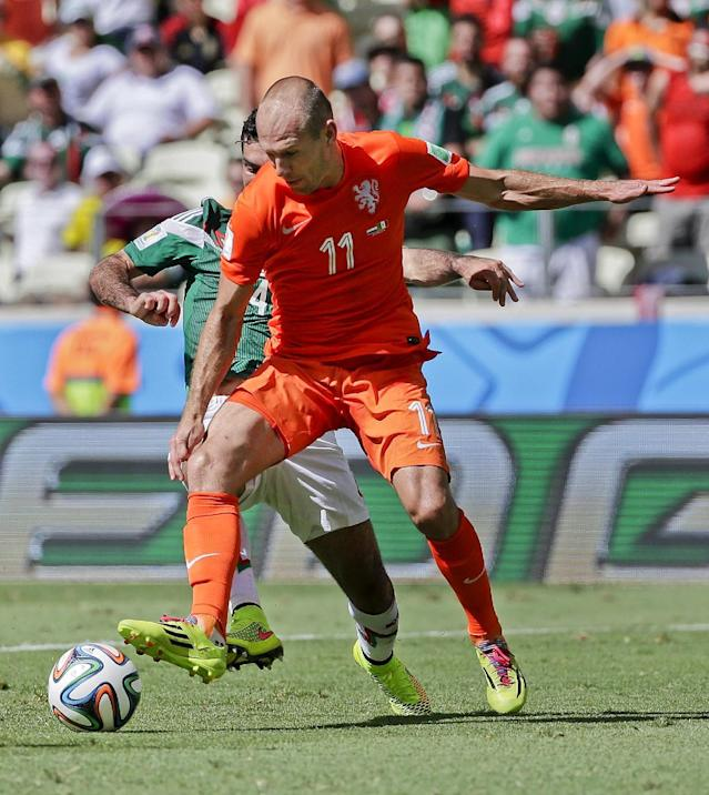 Mexico's Rafael Marquez, left, kicks Netherlands' Arjen Robben on the back of his foot as he tries to clear the ball during the World Cup round of 16 soccer match between the Netherlands and Mexico at the Arena Castelao in Fortaleza, Brazil, Sunday, June 29, 2014. (AP Photo/Felipe Dana)