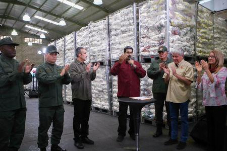 FILE PHOTO: Venezuela's President Nicolas Maduro speaks during his visit to a packing center of the CLAP program, in Caracas