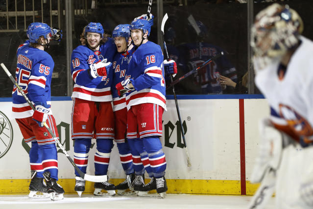 New York Rangers defenseman Ryan Lindgren (55) skates up to Rangers left wing Artemi Panarin (10), Rangers defenseman Adam Fox (23) and Rangers center Ryan Strome (16) after Fox scored against New York Islanders goaltender Semyon Varlamov, right, during the second period of an NHL hockey game, Monday, Jan. 13, 2020, in New York. (AP Photo/Kathy Willens)