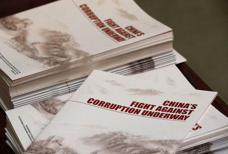 FILE PHOTO: Copies of a booklet from the Central Commission for Discipline Inspection, the ruling Communist Party's anti-graft watchdog, is seen on a table during their news conference in Beijing, China January 15, 2016.REUTERS/Kim Kyung-Hoon/File Photo