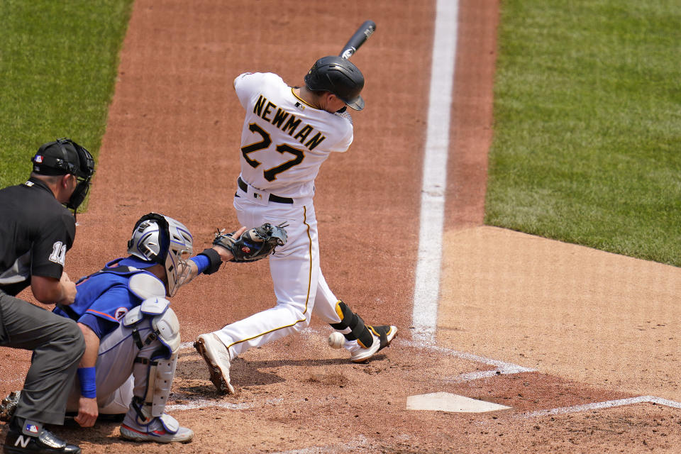 Pittsburgh Pirates' Kevin Newman hits an infield single off New York Mets starting pitcher Taijuan Walker during the first inning of a baseball game in Pittsburgh, Sunday, July 18, 2021. Three runs scored on the single and a fielding error by New York Mets starting pitcher Taijuan Walker. (AP Photo/Gene J. Puskar)