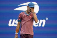 Kei Nishikori, of Japan, reacts after losing a point to Novak Djokovic, of Serbia, during the third round of the US Open tennis championships, Saturday, Sept. 4, 2021, in New York. (AP Photo/John Minchillo)