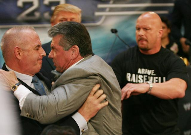 Donald Trump's bodyguard Keith Schiller, left, grabs hold of Vince McMahon, center, as the World Wrestling Entertainment president tries to attack Trump for slapping his face during a press conference in New York, March 2007. (Photo: Bebeto Matthews/AP)