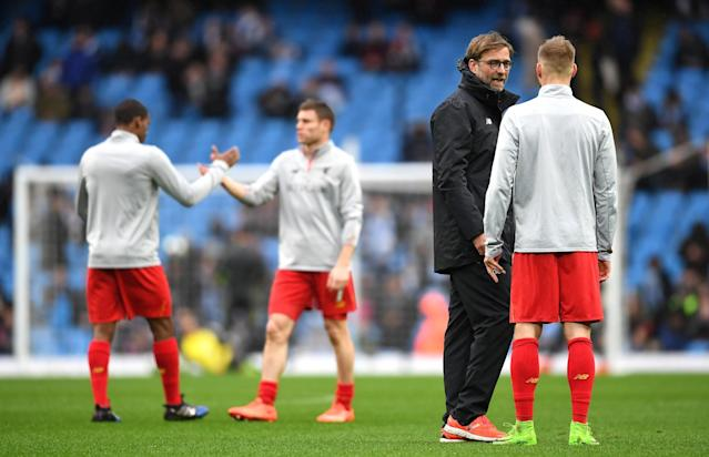<p>Klopp gives his side instructions pre-match </p>