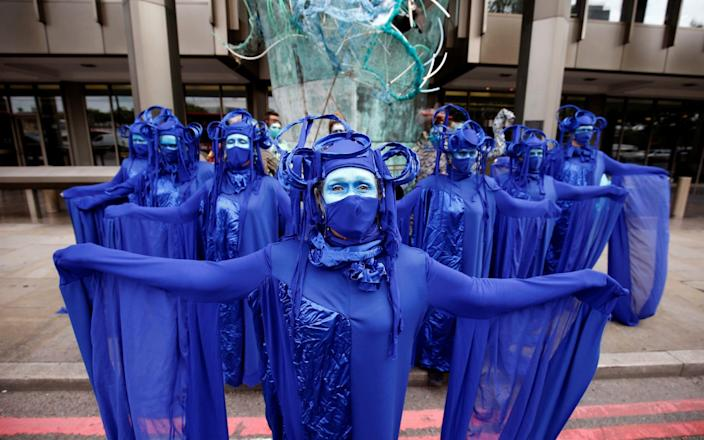 Members of the Ocean Rebellion group attend an Extinction Rebellion protest in London yesterday - Henry Nicholls/Reuters