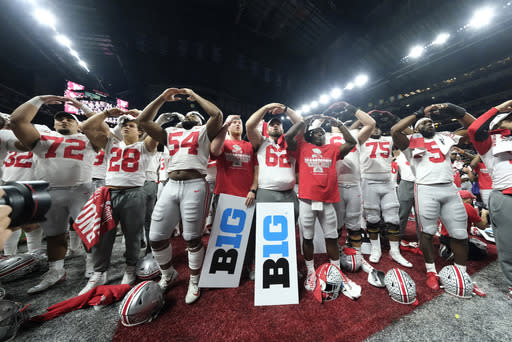 FILE - In this Dec. 8, 2019, file photo, Ohio State players celebrate the team's 34-21 win over Wisconsin in the Big Ten championship NCAA college football game, in Indianapolis. The Big Ten won't play football this fall because of concerns about COVID-19, becoming the first of college sports' power conferences to yield to the pandemic. The move announced Tuesday, Aug. 11, 2020, comes six day after the conference that includes historic programs such as Ohio State, Michigan, Nebraska and Penn State had released a revised conference-only schedule that it hoped would help it navigate a fall season with potential COVID-19 disruptions.(AP Photo/AJ Mast, File)